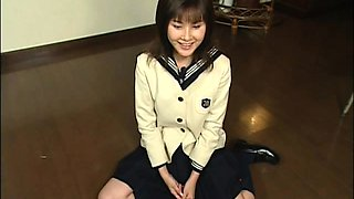 Kinky Japanese teen gets her cute face covered in hot jizz