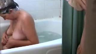 Hot milf is caught by spy cam as she takes a bath