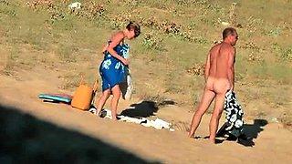 Nudist beach voyeur shoots a busty milf with a tight pussy