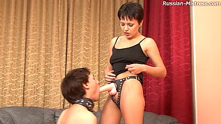 Nimfa just loves to push the strap-on deep into her slave's anus