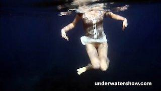 Nastya swimming nude in the sea
