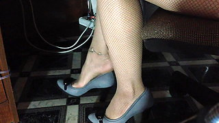Shoes and legs in tights in a dangling mesh