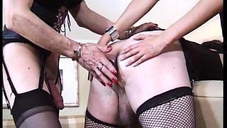 Kinky crossdresser in lingerie enjoys a bisexual threesome