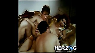 Sexy retro redhead getting banged in a threesome