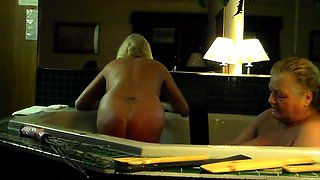 Naughty mature ladies indulge in hot spanking in the bathtub