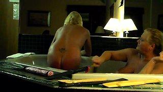 Naughty mature ladies indulge in hot spanking in the bathtub