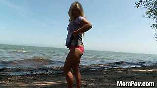 Chubby MILF gets naked at beach