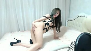 Hot Asian babe shows her big tits on webcam solo