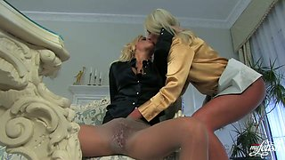 Two glamour lesbians wearing satin clothes suck fingers and touch asses