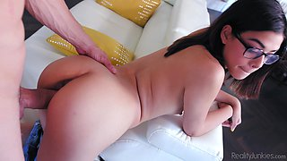 Nerdy brunete babe Harmony Wonder sprayed with cum from a fat dick