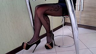 Stockings with a Pattern and High-Heeled Shoes