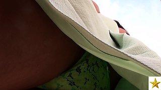 Fascinating European brunette in sexy green panties upskirt