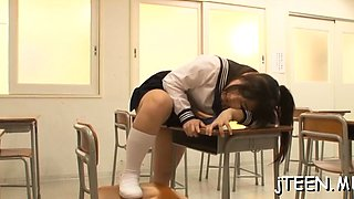 Hot schoolgirl shows her bawdy cleft and sucks on a toy