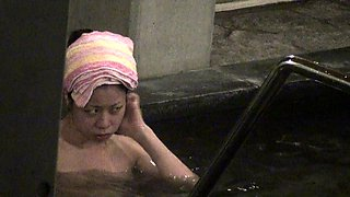 Cute Asian babe gets naked and washes her body on hidden cam