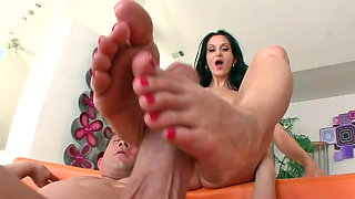 Ava Addams uses her lovely feet while performing footjob