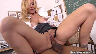 Huge dicked black teacher Ethan Hunt is naughtily fucking his workmate blonde teacher babe Julia Ann on his desk.