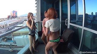 Girls&#39 trio on a hotel balcony in las vegas
