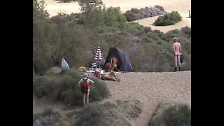 Horny nudist couple go all out at the beach