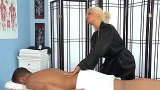 Oiled Busty Masseuse Babe