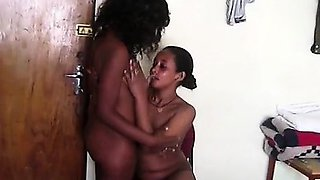 Two big booty African hotties fuck each others coochies in