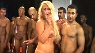 Busty Brazilian blonde in hot gangbang action