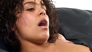 Brunette slut lying in the sofa smoking cigarettes