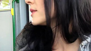Naughty brunette touches herself and blows a cock in public