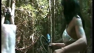 Mistress with great body hits tied slave on his ass and back with a whip in the forest
