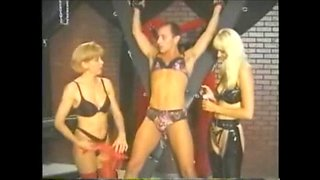 man in panties gets dominated by 2 blondes