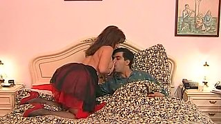 Sweet mature Italian redhead lady on the bed with her man
