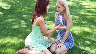 Cute Paisley and another girl like to make out in the park