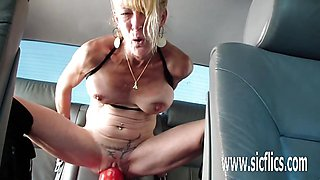 Fucking a gargantuan dildo in her stretched pussy