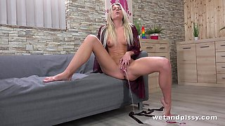 Beautiful blond babe Claudia Macc is pissing and playing with her snatch
