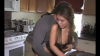 A slim girl takes deep pussy pounding in a kitchen