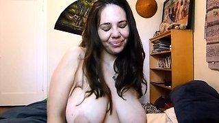 Voluptuous amateur brunette sensually milks her hard nipples