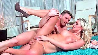 Alluring blonde slurps a hard dick before being penetrated hard