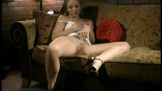 Dazzling solo model in a nylon pantyhose and high heels masturbating passionately