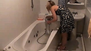 Bathroom hidden camera filming the hot blonde Marina