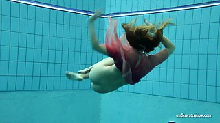 Hot redhead teen cutie underwater looks completely mindblowing