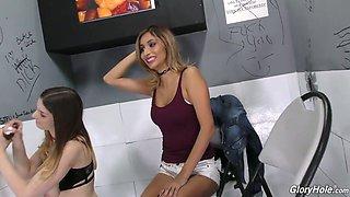 Two whorish chicks enjoys visiting glory hole room