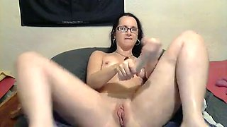 Nerdy brunette white girl on webcam and her big dildo