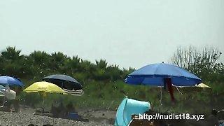 Hot naked girl was slightly spying voyeur hunter on the beach