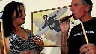 Gorgeous tattooed brunette fucks while smoking cigar
