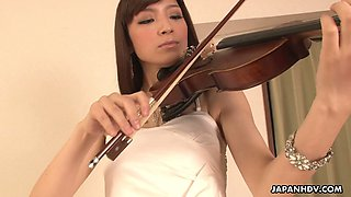 Seductive Japanese violinist Yuria Tominaga allows to fill her pussy with sperm