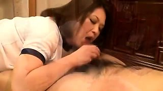 Big breasted Japanese housewife satisfies her need for cock