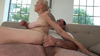 Tattooed granny climbs on the cock and rides it hard