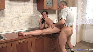 Mom And Dad Enjoy Each Other In The Kitchen