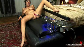 Brunette Sasha Sweet gets her vagina stuffed by a machine