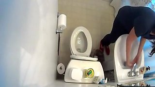 Hidden cam over the toilet catches woman peeing