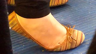 Latina girl flexible arch of her feet in flats.